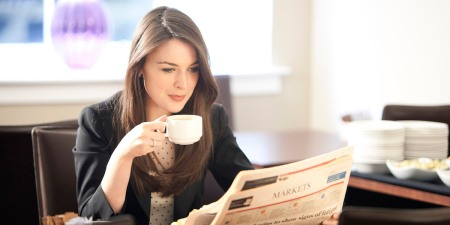 readinglist-model-drinking-coffee-and-reading-1200600